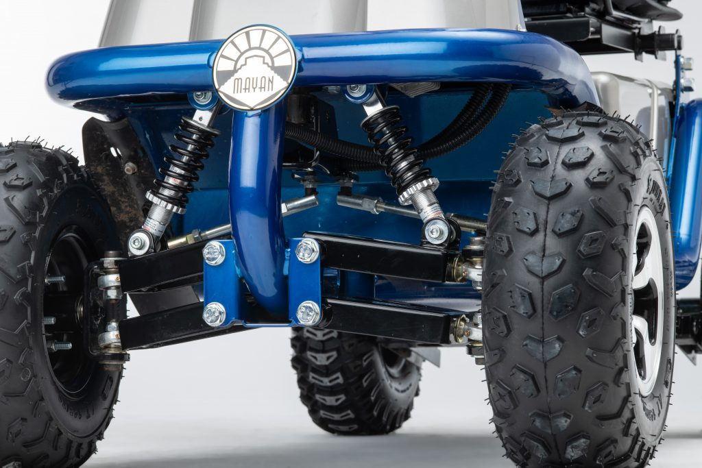 Close up of Mayan AC mobility scooter showing wheels, suspension, badge and tubular frontage