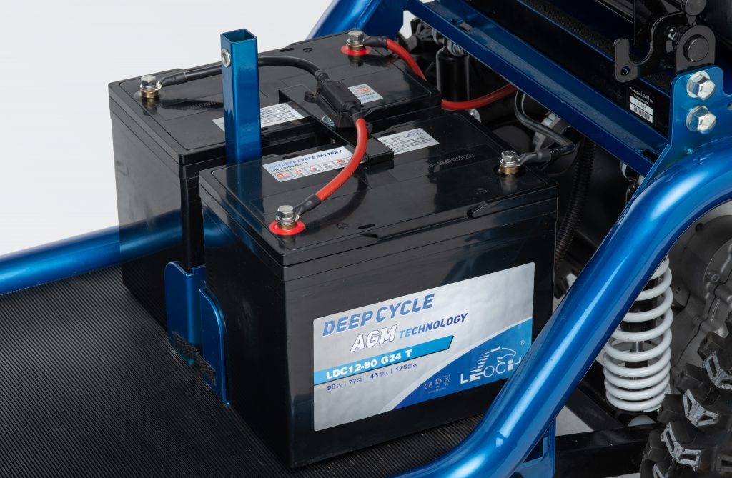 Close up image of deep cycle batteries on mobility scooter
