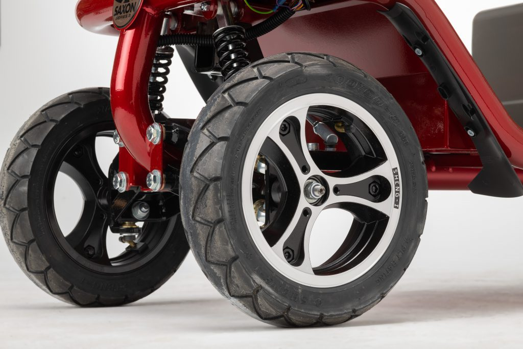 Close up of road wheels and front suspension on mobility scooter