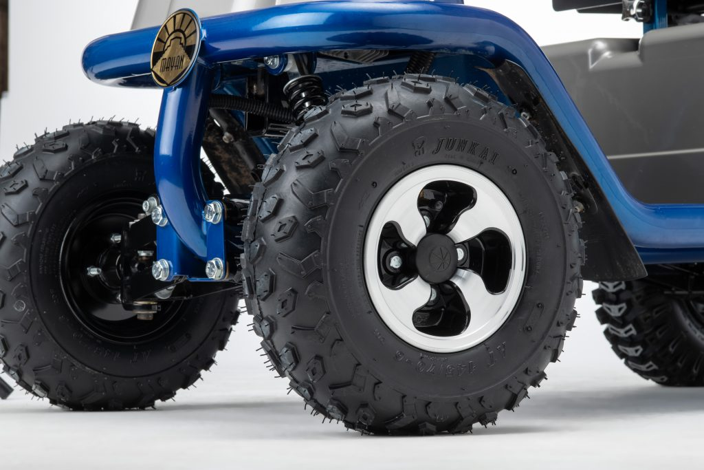 Close up of off road tyres on Mayan mobility scooter
