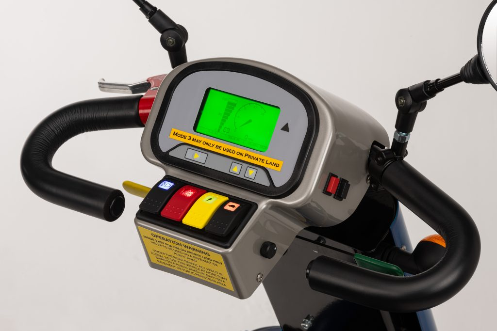 Close up photo of the series3 digital display. It shows several easy-push buttons for lights, horn, battery meter and speed. The green LCD screen shows a battery meter and spedometer